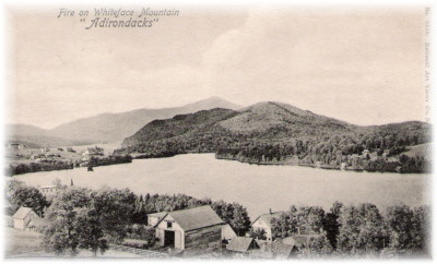 The card reads: 'Adirondack Mts. N. Y.  Fire on Whiteface Mountain <i>Adirondacks</i> It was posted in 1903.'