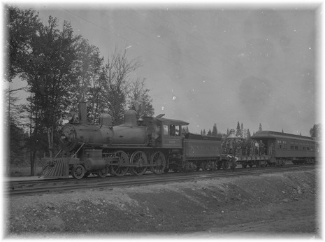 1909-Steam locomotive and railroad cars.