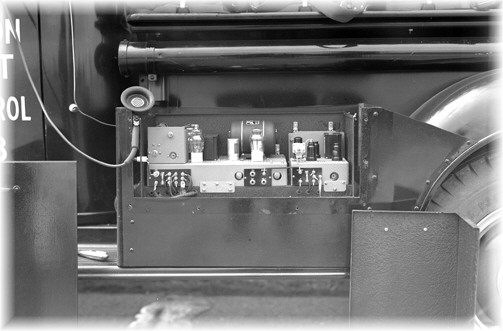 The two-way radio unit mounted on the running board of a 1938 Chevrolet Pickup