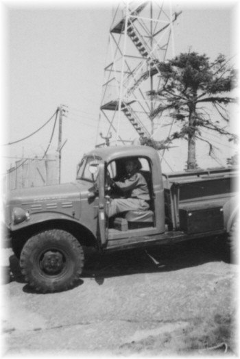 Summit of Blue Mt - Forest Ranger Elmer Morrissey in a US Government Surplus Power Wagon
